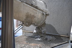 Dumping concrete in pumper machine Stock Image