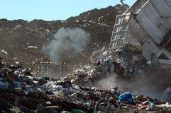 Dumping Garbage at Landfill Stock Photography