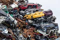 Dumping ground. Scrap metal heap. Compressed crushed cars is returned for recycling. Iron waste ground in the industrial area. Royalty Free Stock Photo