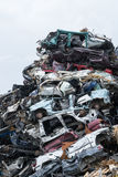 Dumping ground. Scrap metal heap. Compressed crushed cars is returned for recycling. Iron waste ground in the industrial area. Stock Images