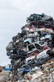 Dumping ground. Scrap metal heap. Compressed crushed cars is returned for recycling. Royalty Free Stock Photos