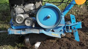 Dumping of land in the garden with a cultivator stock footage