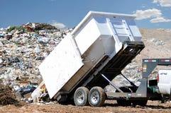 Dumping trash. A big trailer full of trash dumping it at a rubbish dump royalty free stock photo