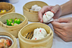 Dumpling and dimsum with hand Stock Photos