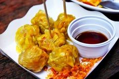 Dumpling with dipping sauce Stock Photos