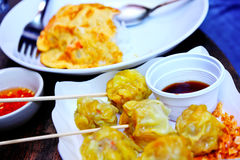 Dumpling with dipping sauce Stock Images