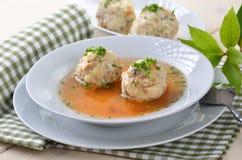 Dumpling soup. Delicious Bavarian bacon dumpling soup (beef broth Royalty Free Stock Image