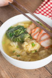 Dumpling soup with red pork and chinese cabbage. Stock Photo