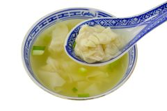 Dumpling soup with spoon. Chinese food - Bowl of dumpling soup with spoon isolated on white background Stock Images