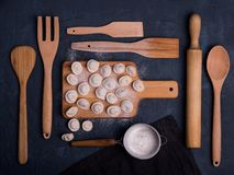 Dumplinga russian ravioli dark top view wood kitchen cooking art table flour stock photo