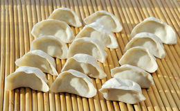 Dumplings. Chinese dumpling is one of the most important foods in Chinese New Year. Since the shape of Chinese dumplings is similar to ancient Chinese gold or Royalty Free Stock Photo