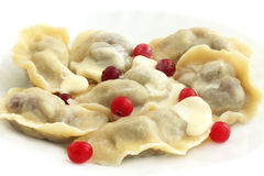 Dumplings. With the berries and the cream Royalty Free Stock Images