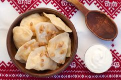 Dumplings with bacon on embroidered tablecloth Stock Photography