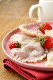 Dumplings with berries and cream sauce Royalty Free Stock Photography