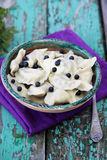 Dumplings with blueberries and butter Royalty Free Stock Image