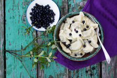 Dumplings with blueberries, top view Royalty Free Stock Photo