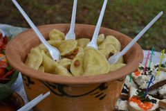 The dumplings are in a a bowl of clay stock photo