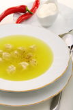Dumplings with broth and red chilli. Stock Photo