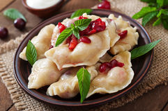 Dumplings with cherries and jam. Delicious dumplings with cherries and jam Royalty Free Stock Image