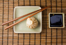 Dumplings and chopsticks Stock Image