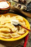 Dumplings with cottage cheese and sour cream. Stock Photo