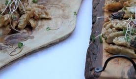 Dumplings dipped in peanut sauce on a wooden board Royalty Free Stock Photo