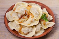 Dumplings, filled with meat and served with salty caramelized onion. Varenyky, vareniki, pierogi, pyrohy. Dumplings with filling, horizontal stock images