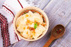 Dumplings, filled with potato and served with fried onion. Varenyky, vareniki, pierogi, pyrohy Stock Images