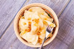 Dumplings, filled with potato and served with fried onion. Varenyky, vareniki, pierogi, pyrohy Royalty Free Stock Image