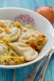 Dumplings with fried onions Royalty Free Stock Photography