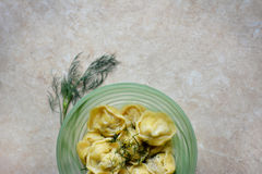 Dumplings in the green bowl with greens stock photos