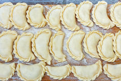 Dumplings on the kitchen board with flour Royalty Free Stock Images