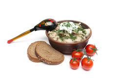 Dumplings with meat in an earthenware bowl, bread and tomatoes o Royalty Free Stock Photo