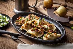 Dumplings with meat, onion and bacon. Stock Images