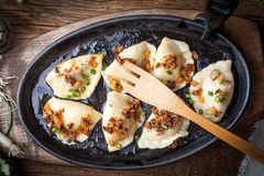 Dumplings with meat, onion and bacon. Royalty Free Stock Images