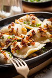 Dumplings with meat, onion and bacon. Royalty Free Stock Image