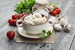 Dumplings with meat. Pelmeni russian national dish Royalty Free Stock Images