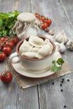 Dumplings with meat. Pelmeni russian national dish Royalty Free Stock Photo
