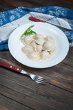 Dumplings with meat  Pelmeni russian national dish Royalty Free Stock Photos