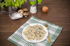Dumplings with mushroom sauce Royalty Free Stock Photography