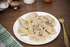 Dumplings with mushroom sauce Royalty Free Stock Images