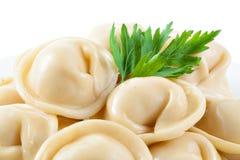 Dumplings and parsley - russian pelmeni - italian ravioli - macr Stock Photos