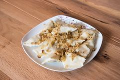 Dumplings on a plate with fried onion Stock Images