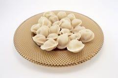 Dumplings. Portion of hot dumplings on a plate Royalty Free Stock Image