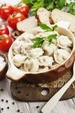 Dumplings in the pot. Delicious dumplings in the pot on the table stock photography