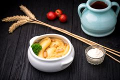 Dumplings with potatoes and cracknel on black wooden background Stock Photography