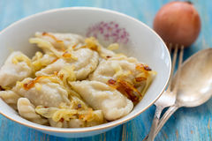 Dumplings with potatoes and fried onions. Royalty Free Stock Images