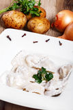 Dumplings with potatoes garnished with Sour Cream, Butter. And Dill. Traditional Russian pelmeni Royalty Free Stock Photos