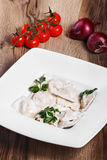 Dumplings with potatoes garnished with Sour Cream, Butter. And Dill. Traditional Russian pelmeni Stock Photo