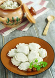 Dumplings with potatoes and mushrooms Royalty Free Stock Photography